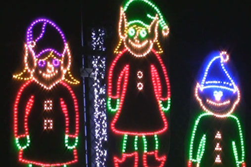The three li'l elves who serve as emcees for Tim Dorr's annual lights display.