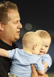 SM East lacrosse coach Chris Kliewer with his children after the Lancers won the 2012 Lacrosse Association of Kansas City title.