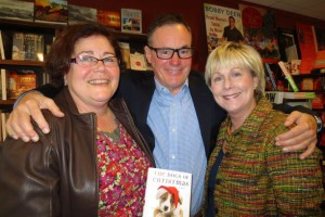 Author Bruce Cameron was greeted at Rainy Day Books by SM East classmates Valerie Bordy (L) and Susan Householter Winters. Photo provided by T. Rooker.