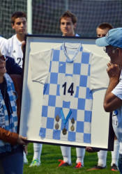 The Rathbuns unveiled Tyler's retired jersey before the SM East soccer game Tuesday. Photo courtesy Denise Tavakolinias.