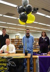 Gunnar Troutwine (L-seated) and Quinn Appletoft sign letters of intent. Standing behind them are (L-R) Myra, Brent and Lars Troutwine, Jarrod , Debra and Ron Appletoft