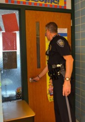 Prairie Village police officers checked to make sure doors were locked during a drill at Briarwood Elementary last week.