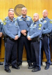Mission police officers who participated in No-Shave November assembled before turning over their contributions to SAFEHOME.