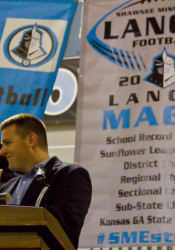 First-year head coach Dustin Delaney stood in front of a banner laying out the team's accomplishments at the annual football banquet Sunday.