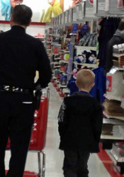 "Prairie Village police helped eight local youth shop find gifts for themselves and their families as part of the ""Shop With a Cop"" program."