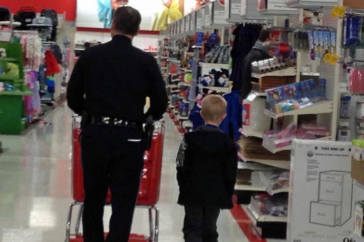 "Prairie Village police help local youth find gifts for themselves and their families as part of the ""Shop With a Cop"" program."