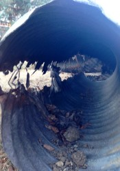The storm water pipe removed from under Roe Lane in Roeland Park shows the extent of damage. The side that is split open and rusted out was the bottom of the pipe or the flow side.