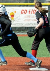 Erin McGinley (rounding the base) is among the top ten outfielders in Kansas.