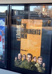 The promotional poster for The Monuments Men outside STANDEES at the Village Shops. George Clooney's character in the film is based on the father-in-law of Prairie Village resident Joanne Stout.
