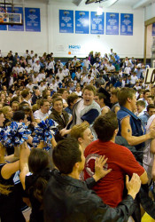 Elated Lancer fans and players celebrated on the court as time expired in SM East's 39-38 victory over rival Rockhurst.