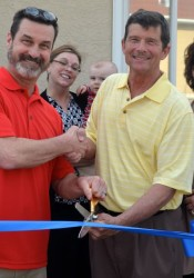 Dr. Irwin Boe and Mission Mayor Steve Schowengerdt cut the ribbon at Advanced Dental with NEJC Chamber President Deb Settle.