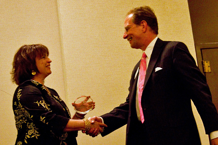 Northeast Johnson County Chamber of Commerce President and CEO Deb Settle congratulated Keith Krieger of Johnson County Community College at the Leadership Northeast graduation last year.