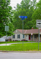 "Some neighbors in the area around 76th and Mohawk Drive found the installation of three ""Keep Right"" signs on the island to be overkill."