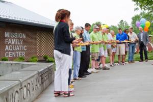 Mayor Steve Schowengerdt cut the yellow ribbon at the pool dedication Saturday.