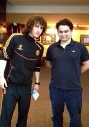 Stanfield (right) with European soccer star David Luiz.