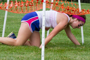 """Hannah Stram, 15, made her way under the cargo net during the """"Net Navigator"""" obstacle."""