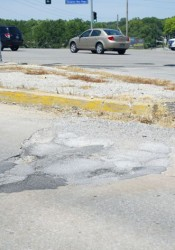 The traffic island and street at 60th and SM Parkway are severely deteriorated.