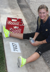 Fairway native Ellie Smart is painting numbers on northeast Johnson County curbs to raise money for her diving training.