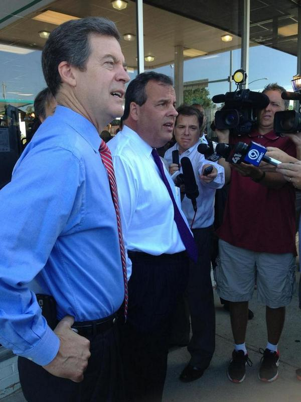 Sam Brownback and Chris Christie talked to reporters outside Oklahoma Joe's before picking up a to-go order. Photo via Brownback for Governor Twitter account.