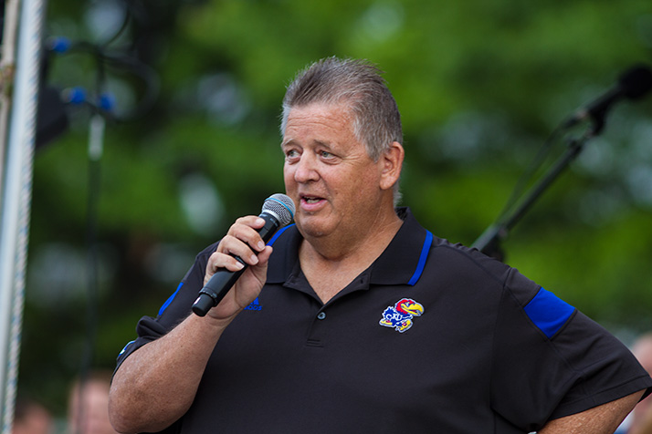 "Charlie Weis told the crowd his team ""expects to play in December."""