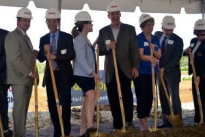 Developer Tom Valenti, in navy suit second from left, was all smiles at the Gateway groundbreaking in August 2013.