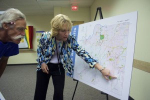 Johnson County Parks Director Jill Geller answers questions from Richard Voss at an open house at Antioch Library Tuesday night designed to get input about the future of the county parks.