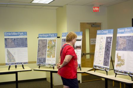 Visitors to the open house Tuesday looked over display boards on each of the county parks and then submitted comments.
