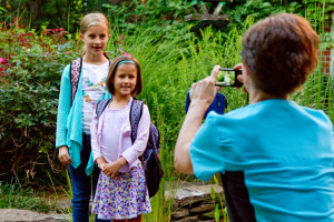 Laura Moffett snaps a first-day-of-school photo of daughters Alexandria (left) and Cate.