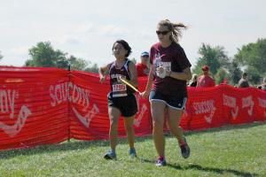 Meg Shemer and Kristine Tardiff running at the Greg Wilson Classic at Johnson County Community College. Photo courtesy Doug Jones.