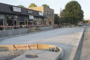 Construction crews are making progress on installing new parking areas along Johnson Drive.