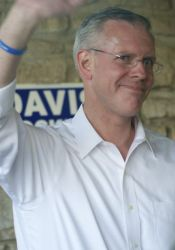 Paul Davis was greeted by Johnson County Democrats at a rally in Harmon Park Saturday.