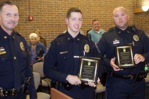Prairie Village Police Chief Wes Jordan (L-R)) presented the department's Lifesaving Award to officers John Shipman and Joel Colletti.