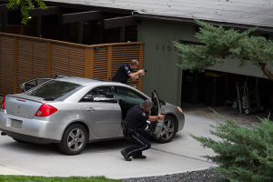 Prairie Village police investigators pulled their weapons as they swept a previously unchecked garage during their investigation after an afternoon burglary that led to the arrest of three men.