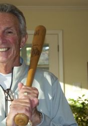Alex George in his Prairie Village home with one of the autographed bats provided to him by Louisville Slugger in his playing days.
