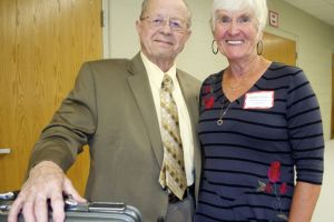 Former Indian Hills Principal Charles Rocklage and Assistant Principal Barbara Evans reunited at the Indian Hills 60th anniversary. Rocklage brought with him the briefcase the staff gave him as a going-away present in 1977.