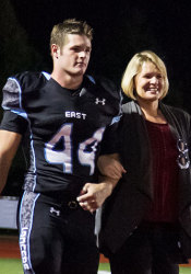 Ball with his mother during the Homecoming game.
