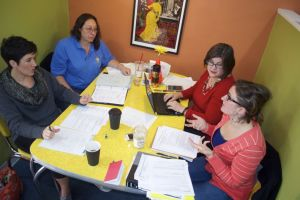 Leadership Northeast alumni (clockwise from bottom left) Kinsley Riggs, Beth Berier and Teresa Kelly meet with the Chamber's Lauren Vaughn to plan the 2015 session recently at Twisted Sisters Coffee Shop.