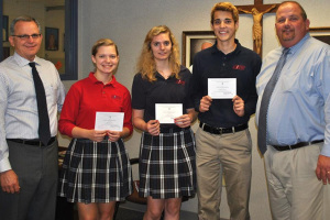 Bishop Miege students Hannah Long, Manion Kuhn, and Andrew Gleason with Dr. Joe Passantino (left) and teacher Randy Salisbury