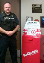 Officer John DeMoss with the new Roeland Park drop box.