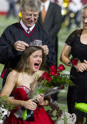 Kelsie Sneegas accepts the Homecoming Queen crown from SM North Principal Dick Kramer. Also, this is my favorite photo ever.