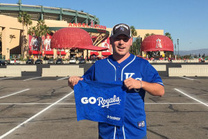 Tim Grimes in Anaheim during last season's baseball playoffs. Grimes has been well enough to attend Royals road games this season as well.