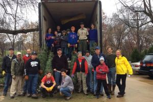 Members of Boy Scout Troop 192 from Old Mission Methodist Church helped unload Christmas trees at the Shawnee Indian Mission.