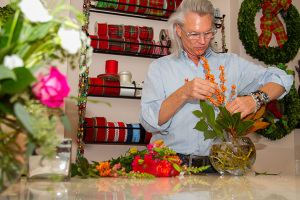 Chuck Matney worked on a floral arrangement in the store Wednesday.