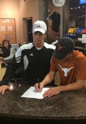 Johnny Goodwin signing his letter of intent for Texas. Photo via Twitter.