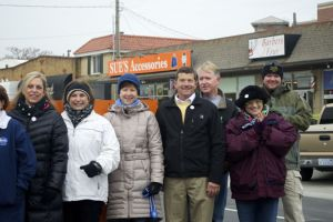 Mayor Steve Schowengerdt and former mayor Laura McConwell were among those gathered to knock down the Johnson Drive barricade.