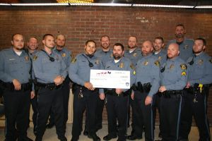 Mission police officers donated money to recognize domestic violence awareness month during No-Shave November.