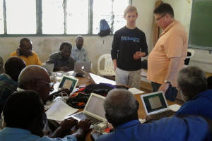 Alex Lang worked alongside three other volunteers to teach New Guinea men how to use computers for communication.