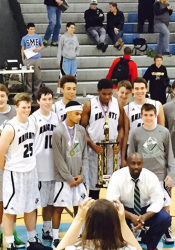 Barstow's basketball team celebrated with the Championship Showdown title trophy on the SM East court Saturday. Photo via Barstow Booster Twitter.