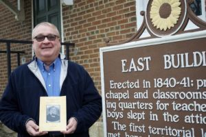 Author Joe Vaughan at the Shawnee Indian Mission with his new book that traces the history of the Mission and Fairway.