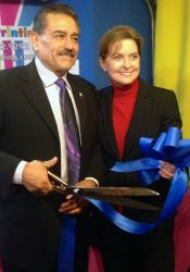 Jose and Tina Ramirez cut the ribbon to open the Moss Printing location in Merriam.